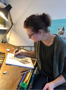 Nicole thuis aan het werk